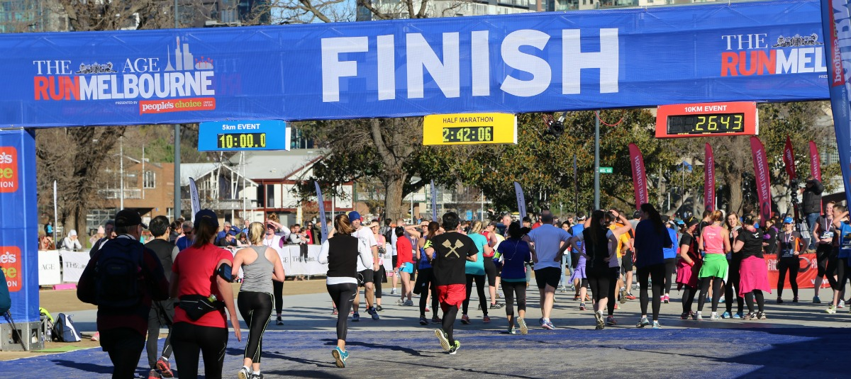 Image of runners crossing the Run Melbourne finish line.