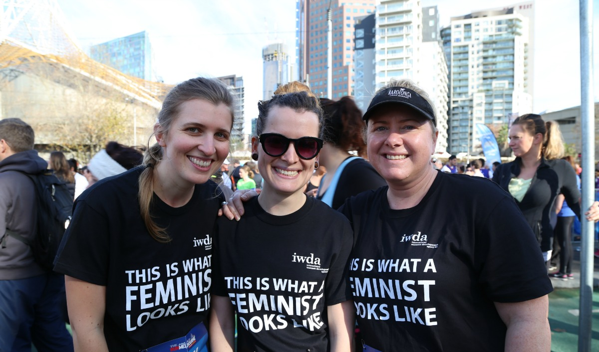 Image of 3 women standing together, smiling after finishing Run Melbourne.