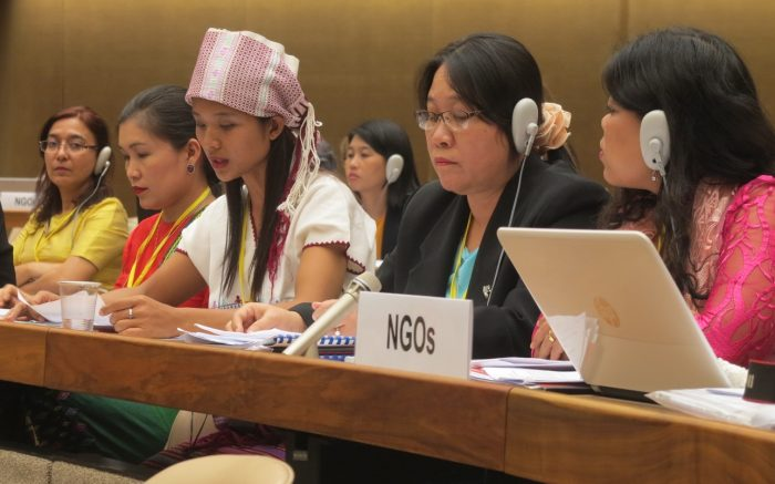 Myanmar's NGO delegation make their joint statement to the CEDAW Committee. Naw Hser Hser is in the pink headdress. Photo: WLB