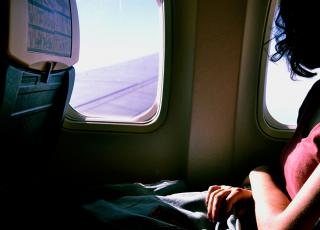 Woman on an airplane. Photo: Sofia Sforza/Unsplash